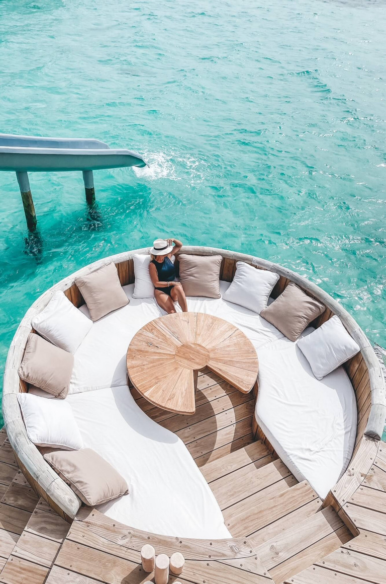Dining table on the deck of the water villa at Soneva Jani