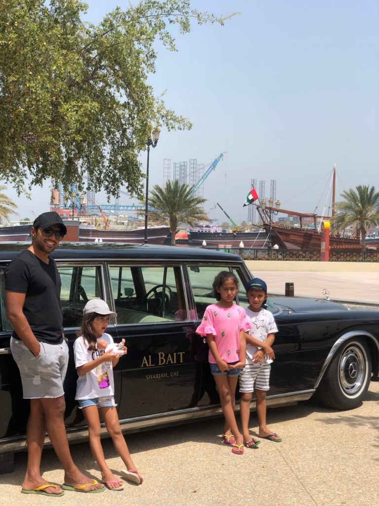 Front of the hotel with the vintage car