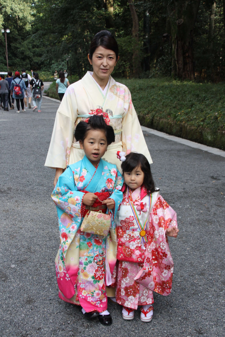A family dressing up when visiting a shrine