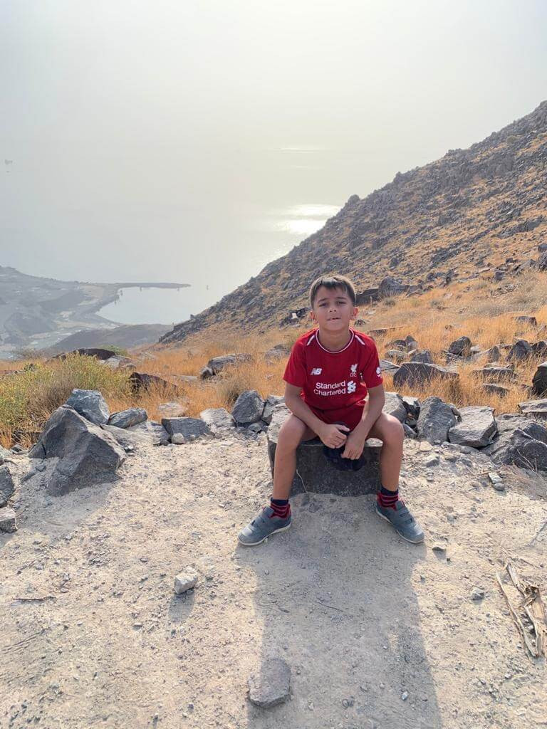 He did it... he climbed to the top of Al Rabi Hiking Trail