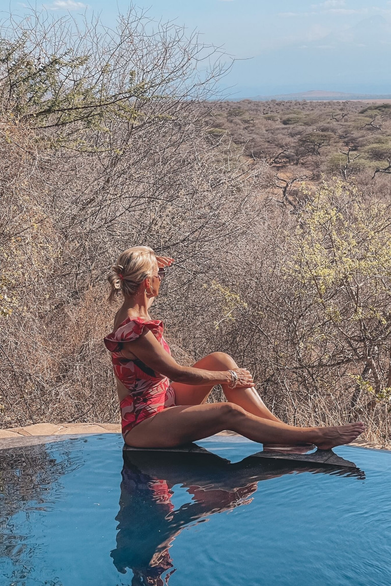Looking out at the watering hole from our private pool