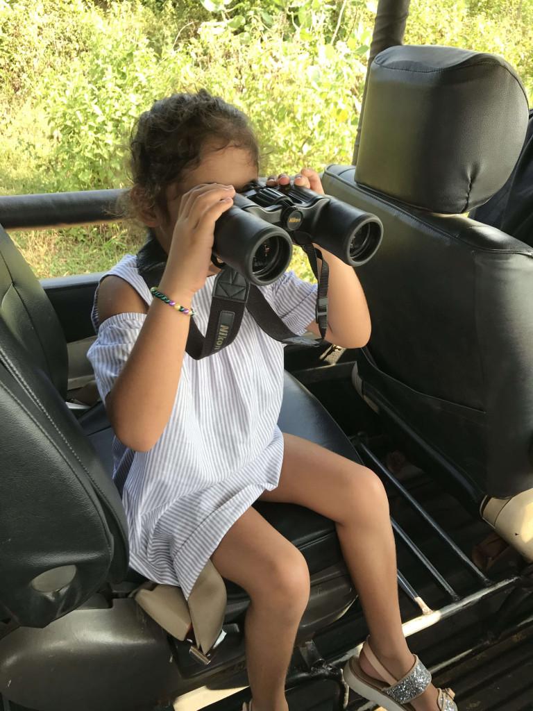 She cant put the binoculars down!