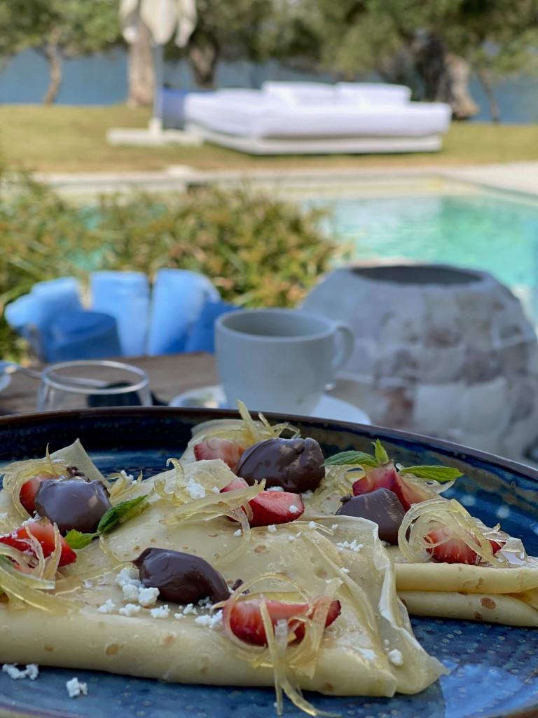Breakfast around the villa pool